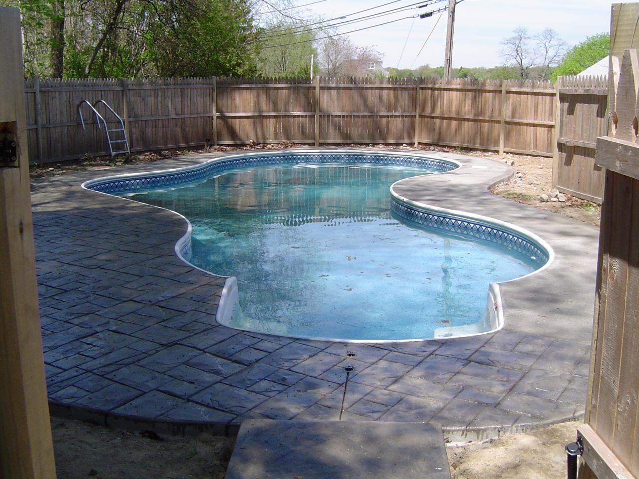 Artistic concrete stamped concrete pool aprons pool for Concrete pool